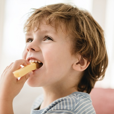 Boy Eating Cheese